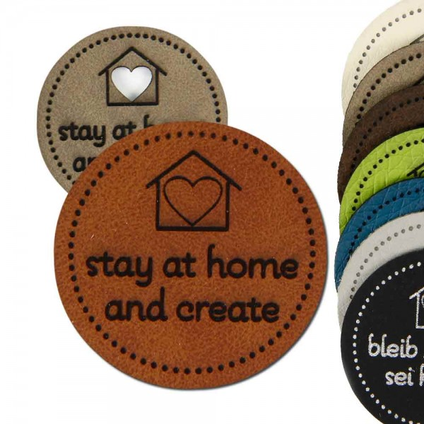 "Synthetic leather labels, with the inscription ""stay at home - and create"""